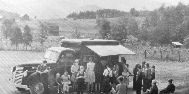"""A """"book mobile"""" serving children in Blount County, Tennessee, United States, in 1943"""